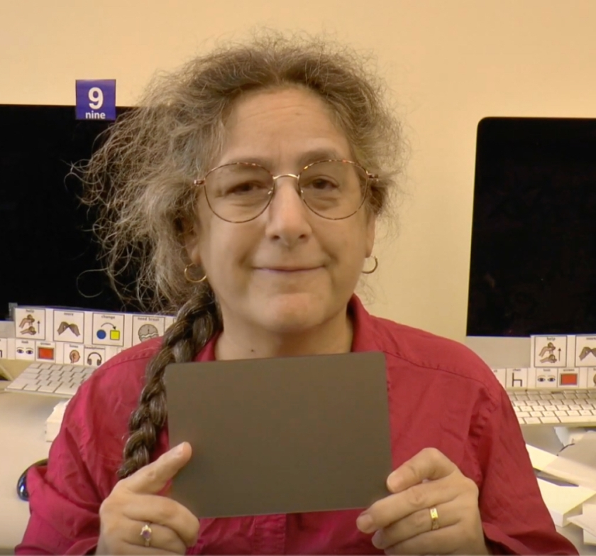 Jeanne Stork is holding a trackpad.